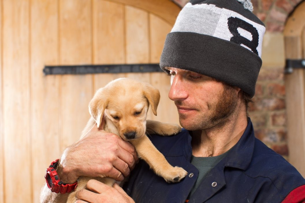 Guy Martin with a puppy wearing a Bobble Hat